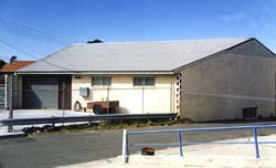 Colour picture: the AMRA NSW Rockdale clubrooms in 2000. The roof profile of the original building can be seen.