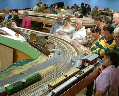 An Open Day crowd fills the corridors between the O gauge layout (foreground) and the HO (background)